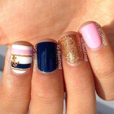 Pink gold & navy nails