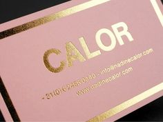gold foil on pink embossed paper