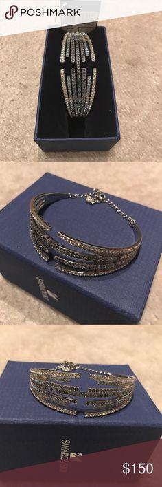 Swarovski bangle bracelet NWT gorgeous! It comes with box. I just have too many shiny bracelets. Price is pretty firm. Swarovski Jewelry Bracelets
