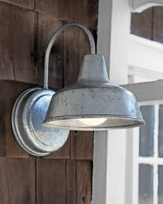 A downward glow is gentler and more flattering than the light cast by an upward-facing bulb. This gooseneck lamp's galvanized finish gives it an informal, slightly aged look that fits right in with the cottage's aesthetic.  Austin sconce, barnlightelectric.com.