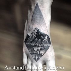 Dotwork style landscape rhombus tattoo on the right foot. Tattoo...
