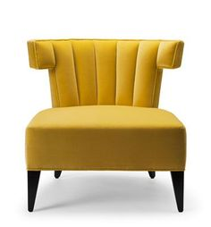 THE ISABELLA SLIPPER CHAIR BY STUART SCOTT. Shown here upholstered in primrose yellow cotton velvet, with legs in ebonised walnut.  Hand signed and individually numbered.  stuartscott.co.uk