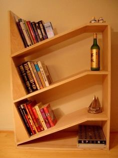 Gravity is your friend / Woodworking Projects I love this idea for a bookshelf instead using the bookends that just don't always work or fit in.. I just have too many books