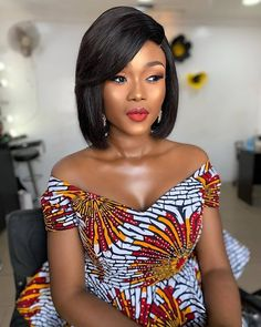 Ankara and African Print dress Styles Cameroonian actress Lucie Memba Bos stuns in new photograph. The actress photographed by Penjo Studios wore a bold and vibrant African print over the knee dress African Fashion Ankara, Latest African Fashion Dresses, African Dresses For Women, African Print Fashion, African Attire, African Women, African Blouses, African Tops, African Style