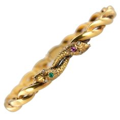 Victorian Two-Headed Snake Gold Bracelet. This awesome Victorian bracelet consists of twisted flexible links in 18 karat yellow gold and features a two-headed snake with little rose cut diamond eyes and a small ruby and emerald on the heads with intricate scale details on the snake heads. Circa 1900.