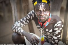 Tribal: A Karo man in the Omo Valley of Ethiopia looks into the lens in this show by Sean Caffrey.