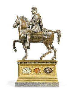 An Italian bronze Marcus Aurelius on horseback, After the Antique, on an associated gilt-bronze, pietre dure and silvered bronze and green porphyry base 19th century after the model of Marcus Aurelius on the Capitoline, Rome, on a rectangular plinth with an alternating band of beading and patera above roundels of various jaspers and with raised flowerheads on a green porphyry base