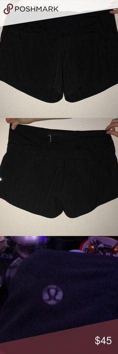 Black Lulu lemon speed shorts Black lulu lemon speed shorts  Long Good condition  Logo is a little worn but not noticeable lululemon athletica Shorts