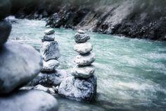 River flowing meditative stones