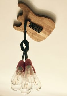 Ceiling light for music lovers!!i used oak wood,grey fabric cables and red porcelain lamp sockets.