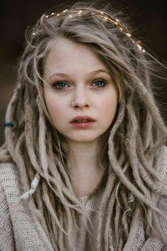I cannot understand why a girl so pretty would have dreadlocks in her hair! Dreads always look so dirty to me..I do apologize to those who have and enjoy them for my blatant honesty.