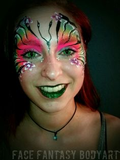 Neon butterfly facepaintdesign by Face Fantasy BodyArt.