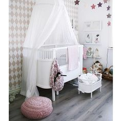 Love the idea of a draped bed canopy over baby's crib or bassinet!
