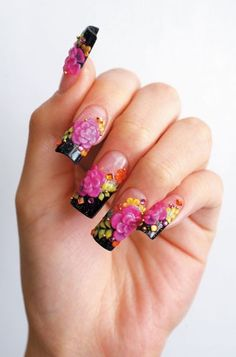 Black, pink, green, and yellow themed floral nails.