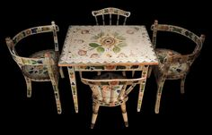 """Rare Norwegian child's """"tea party suite"""" consist of 2 three-legged chairs, 2 side chairs, and a table all painted with Rosemaling flowers on a desirable white background. C. 1890. Leatherwood Antiques. http://www.leatherwoodantiques.com/"""