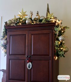 Great idea for decorating the top of an armoire or TV cabinet for Christmas. Don't forget about those spaces!