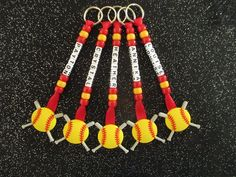 PERSONALIZED NAMED SOFTBALL KEYCHAINS/ BAG TAGS IN YOUR TEAMS COLORS AND NAMES New without tags - handmade with love.  A set of personalized softball key rings / bag tags with your teams colors and names to attach to keys, sports bags, etc - see other listings for netball, basketball, tennis, hockey, soccer and baseball. These key rings are approximately 15cm long depending upon name. They are individually packaged for presentation. The ribbon and bead colors are personalized to mat...
