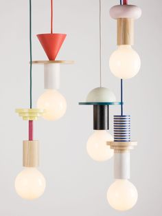 "Geometric coloured timber components stack to create quirky pendant lights. ""Modular geometric pendant lights by the northern-German design studio Schneid"". Blitz Design, Geometric Pendant Light, Style Deco, Luminaire Design, Deco Design, Design Trends, Design Ideas, Geometric Designs, Geometric Art"