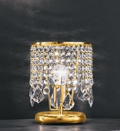 Abatjour Kimera   Bedside Collection Kimera, in 24% PbO hand-blown crystal. Available with 24 KT gold or nickel.