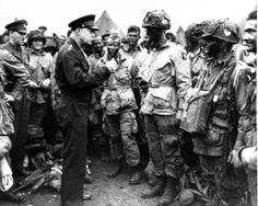 Ike addressing the troops before the D-Day invasion.  The soldier with the sign that says 23 is from Saginaw, Michigan