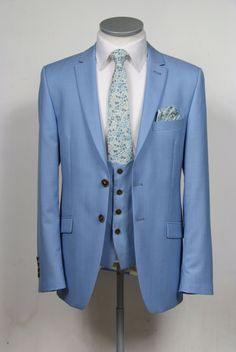 Grooms wedding suit in sky blue pure wool, 2 button single breasted suit with narrow peak lapel and low scoop waistcoat. To purchase £645 for a 3 piece suit. Shown here with blue liberty print tie, available in other colours and cloths #groom #wedding #suit #bespoke #madetomeasure #blue #waistcoat #doublebreasted #liberty #vintage