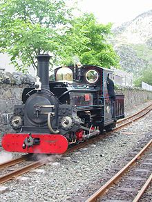Ffestiniog Railway nr Portmeiron The railway is roughly 13 1⁄2 miles (21.7 km) long and runs from the harbour at Porthmadog to the slate mining town of Blaenau Ffestiniog, travelling through forested and mountainous scenery. It is the oldest surviving railway company in the world