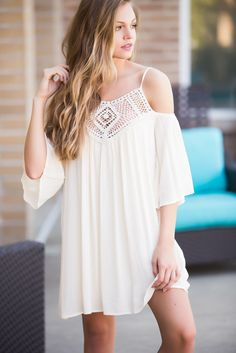 Delicate Crochet accents the neckline of this A-line frock. Perfect for country concerts!