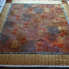 Hand dyed and stamped table topper