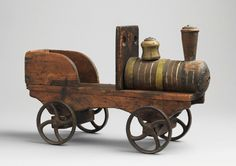 Hand Carved and Painted Wood   With Original Cast Iron Wheels and Metal Details   English, c.1880