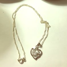 """Silver love necklace with crystal accent Delicate chain with a heart charm that spells love with a crystal """"o"""" accent Jewelry Necklaces"""