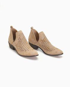 """<p>A pair of stylish booties featuring a soft faux suede upper, a perforated design, side-slits, and a comfy fit.</p>  <ul> <li>4"""" Shaft</li> <li>2"""" Heel</li> <li>Pull-on Construction</li> <li>Lightly Padded Footbed</li> <li>Textured Sole</li> <li>Man Made Materials</li> <li>Imported</li> </ul>"""