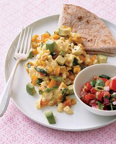 Pump up your morning egg scramble with salsa, avocado, corn, and white cheddar.