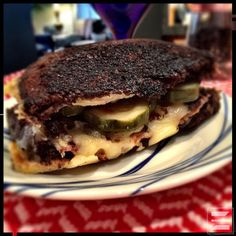 Grilled cheese grows up with Taleggio and Fontina cheeses plus bacon, sliced pear and a bit of mayonnaise on pumpernickel. Even better with a couple of slices of beer pickles added.