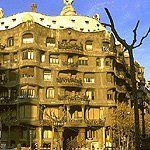 The Casa Mila was designed by Antonio Gaudi in 1905. It is designed in the art nouveau style and it attempts to look as if  it is growing out of its environment. It is a multifamily housing unit. Gaudi designed the rippling shelves and cave balconies to mimic mountains or a stone quarry. This structure is located in Barcelona, Spain.