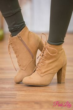 We are in love with these stunning lace-up booties! From the classic camel color to the rounded toe, they are simply the perfect way to welcome fall in style! The exterior is a suede like material tha