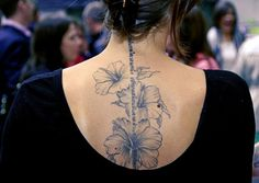 Hibiscus Tattoo on back Tattoo Designs For Girls, Tattoo Sleeve Designs, Sleeve Tattoos, Trendy Tattoos, All Tattoos, Tattoos For Guys, Tatoos, Spine Tattoos For Women, Tattoos For Women Small