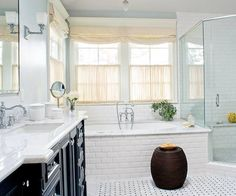 White tile, dark vanity, hardware