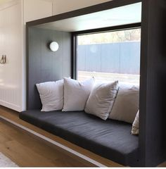 Black timbered window seat with lights and sticking out