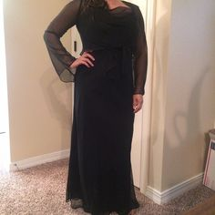 """BLK w/RED SHIMMER FORMAL DRESS💞 Perfect condition, beautiful formal gown/dress. Black with a slight red shimmer (not glitter! #4). It is a light overlay with a silky liner. Can be worn without the shawl cover.  Draping goes from chest around back of dress (#2). Slight bell sleeve.Worn one time to formal event and received a lot of compliments. I am 5""""1' and it hits the top of my feet, just as in pic #1.  Will best fit waist <30"""".  Excellent condition. No snags, stains, tears, or…"""