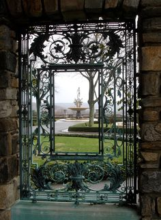 "An ornate window guard framing a view of the 30 foot high, monumental fountain of ""Oceanus and the Three Rivers"" at Kykuit in Pocantico Hills, NY."