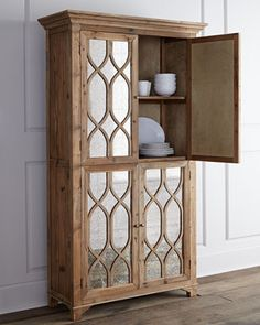I know this is $$ but this would look gorgeous!  Kady Antiqued-Mirror Cabinet