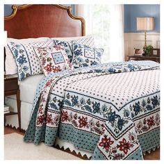 Cotton quilt set with a scrolling floral border.   Product:  Queen: 1 Quilt and 2 standard shams King: 1 Quilt a...