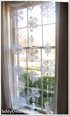 How to make a Snowflake-window-treatment. Free cutting patterns to make your own.