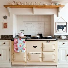 """Set a classic cream Aga into a chimney breast with a mantel shelf above to create the quintessential country kitchen. Classic Kitchen, Vintage Kitchen, Vintage Oven, 1930s Kitchen, Kitchen Rustic, Aga Kitchen, Kitchen Cooker, Kitchen Worktop, Kitchen Cabinets"