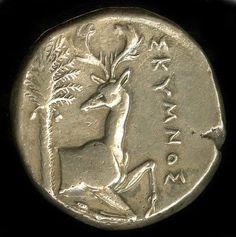 """Reverse of the honeybee coin, with the deer of Artemis.Priestesses of Artemis are """"melissae"""" - """"honey bee"""" in Greek."""