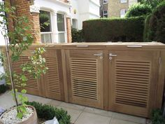 Bespoke bike storage/bin storage in iroko