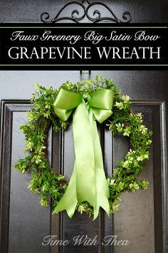 Faux Greenery Big Satin Bow Grapevine Wreath ~ Easy instructions for how to make a wreath using faux greenery garland and a gorgeous big green satin bow! / timewiththea.com