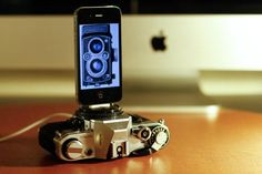 Old film SLR camera turned into an iPhone dock