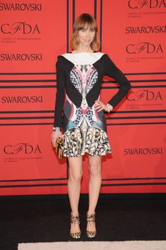 SHOP THE LOOK: Graphic set  Anya Ziourova has made the perfect choice of this fall by styling her Peter Pilotto dress with animal print sandals and a golden touch.