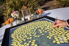 Creative Guestbook for Wedding - Guests sign their names on the leaves by Brandon Wong Photography (http://www.brandonwongphotography.com)
